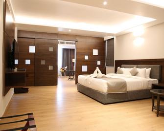 Native By Chancery Hotels - Belgaum - Bedroom