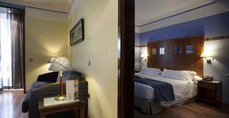 Suites Gran Via 44 Apartahotel - גרנדה - חדר שינה