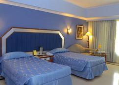 Hotel Swosti Premium - Bhubaneswar - Bedroom