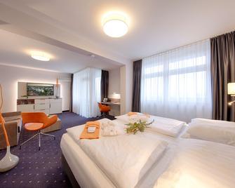 BEST WESTERN PLUS Hotel Steinsgarten - Гіссен - Спальня