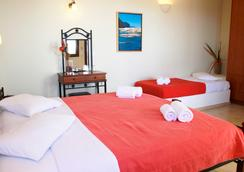 Amerisa Suites - Thera - Bedroom