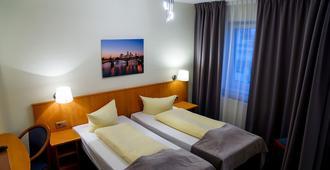 Hotel Niederräder Hof - פרנקפורט אם מיין - חדר שינה