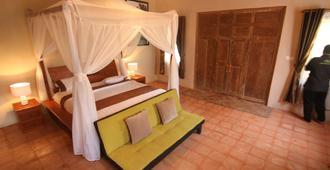 Rajaklana Resort, Villa And Spa - Yogyakarta - Schlafzimmer