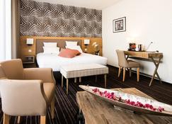 Brit Hotel Lodge - Straßburg - Schlafzimmer