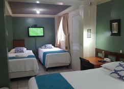 Hotel Tazumal House - San Salvador - Schlafzimmer