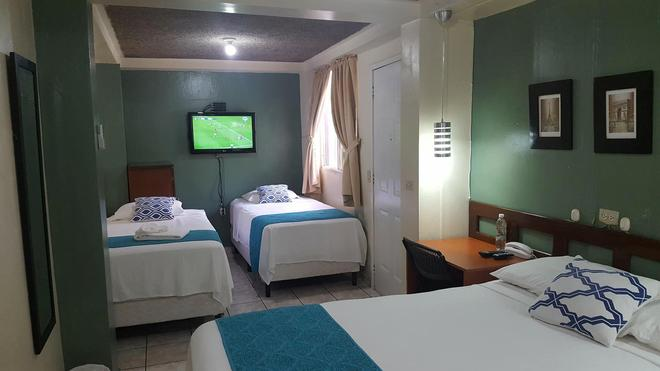Hotel Tazumal House - Сан-Сальвадор - Спальня