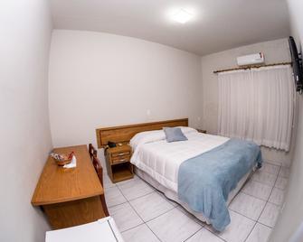 Santa Rosa Hotel - Assis - Schlafzimmer