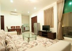 Song Hung 1 Hotel & Serviced Apartments - 胡志明市 - 客廳