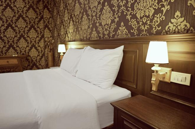 Romena Grand Hotel - Chiang Mai - Makuuhuone