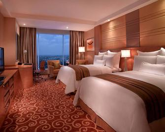 JW Marriott Hotel Medan - Medan - Bedroom