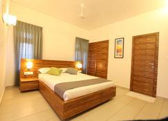 The Woods Resorts Wayanad - Koleri - Schlafzimmer
