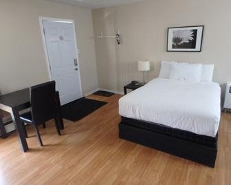 Wheel Inn Motel - New Liskeard - Schlafzimmer