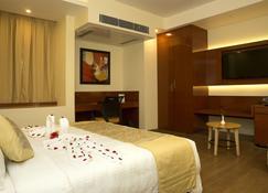 Hotel Amalfi Grand - Патна - Bedroom