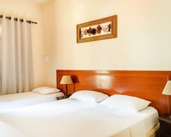OYO Hotel Pouso Das Minas Gerais - Барбасена - Спальня