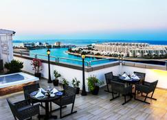 Ramada Hotel & Suites by Wyndham Amwaj Islands Manama - Muharraq - Balcony