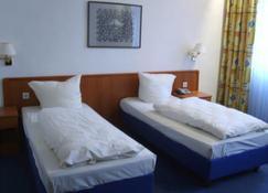 四季飯店 - 海德爾堡 - 臥室