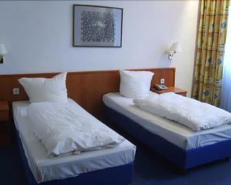 Vier Jahreszeiten - Heidelberg - Soveværelse