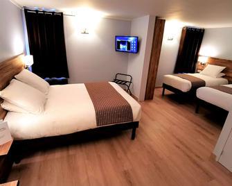Brit Hotel Confort Pau Lons - Lons - Спальня