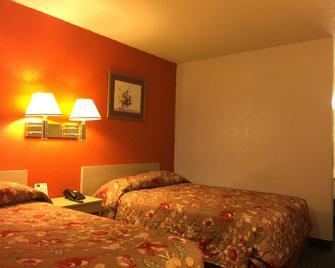 QC Stay Inn - Молин - Спальня