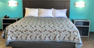 Euro Inn and Suites Slidell - Slidell - Bedroom