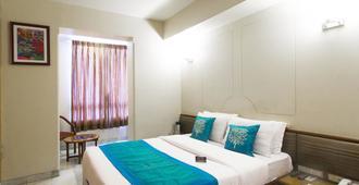 Oyo 1249 Hotel Ashray International - מומבאי - חדר שינה