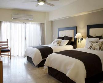 Marinaterra Hotel & Spa - San Carlos - Schlafzimmer