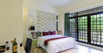Huaman hot spring villa - Puli - Schlafzimmer