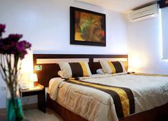 MC Suites - Guayaquil - Yatak Odası