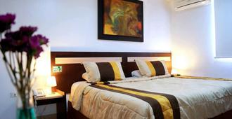 MC Suites - Guayaquil - Camera da letto