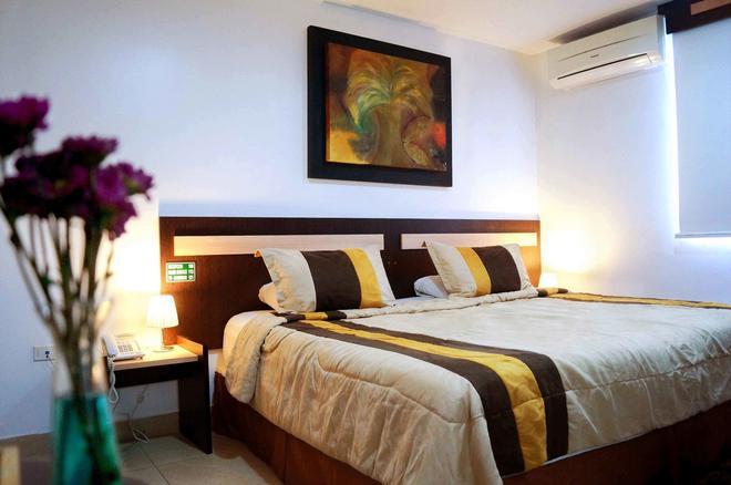 MC Suites - Guayaquil - Makuuhuone