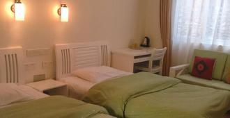 Four Seasons Youth Hostel - Dali - Schlafzimmer