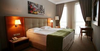 Cityhotel - קייב - חדר שינה