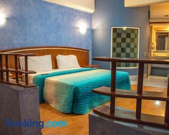Autohotel Ilussion - Córdoba - Schlafzimmer