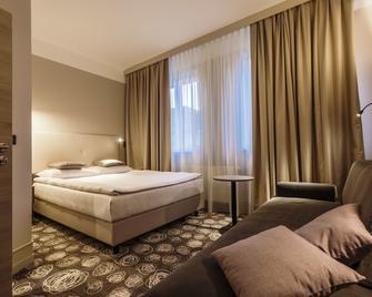 Hotel Center - Rudolfswerth - Schlafzimmer