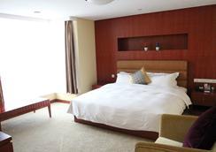 Tianrun Jinwang Hotel - Qingdao - Bedroom