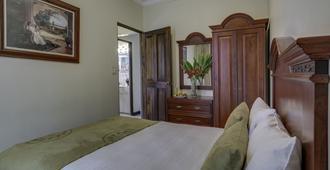 Casa Conde Hotel & Suites - San José - Bedroom