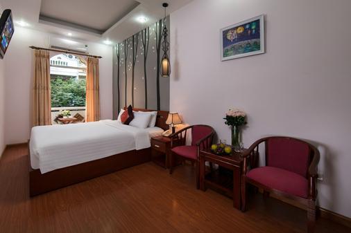 Hanoi Rendezvous Hotel - Hà Nội - Phòng ngủ