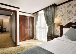Hawthorn Suites by Wyndham Al Khobar - Al Khobar - Schlafzimmer