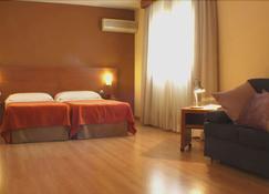 Hostal Y Apartamentos Torre Monreal - Tudela - Camera da letto