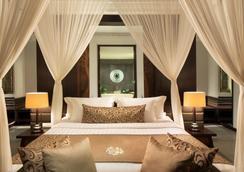 White Rose Kuta Resort, Villas & Spa - Kuta - Bedroom