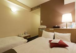 Hotel Shinsaibashi Lions Rock - Osaka - Bedroom