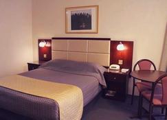 Charbonnier Motor Inn - Singleton - Bedroom