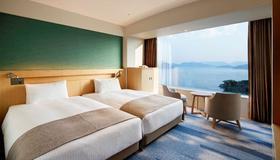 Grand Prince Hotel Hiroshima - Hiroshima - Bedroom