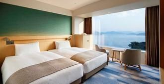 Grand Prince Hotel Hiroshima - הירושימה - חדר שינה