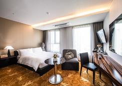 Hotel Leo - Thành phố Jeju - Phòng ngủ