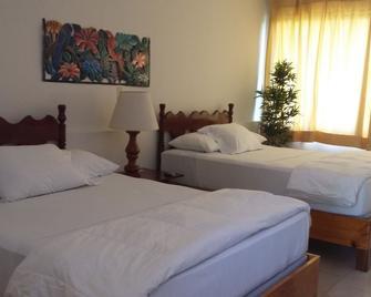 Hotel Mont Joli - Кап-Аїтьєн - Bedroom