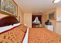 Americas Best Value Inn & Suites Chincoteague Island - Chincoteague - Bedroom