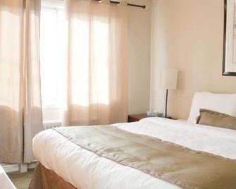 Beausejour Hôtel Appartements - Dorval - Bedroom