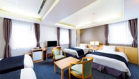 SureStay Plus Hotel by Best Western Shin-Osaka - Osaka - Bedroom