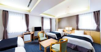 SureStay Plus Hotel by Best Western Shin-Osaka - Osaka - Bedroom